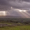 Sun over Yorkshire Dales. Keywords: Andy Morley;Yorkshire;Dales;Sun;yorkshire dales;ingleton;ingleborough;Forest of Bowland;sunburst;crepuscular;rays;cloud;dry stone wall;moor